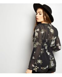 New Look - Black Chiffon Floral Print Bell Sleeve Tie Front Top - Lyst