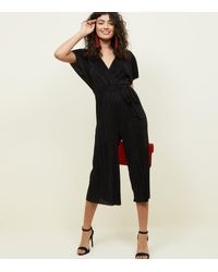 37037a633080 New Look Black Plissé Wrap Front Culotte Jumpsuit in Black - Lyst