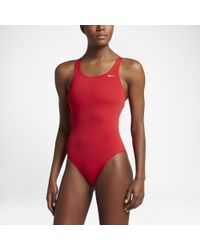 ddf24fddb58 Nike Poly Core Solid Fastback Women's Tank Swimsuit in Red - Lyst