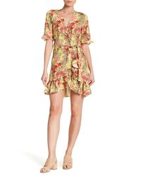 Haute Rogue - Yellow Ruffled Tropical Wrap Dress - Lyst