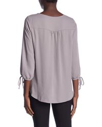 Pleione - Purple 3/4 Length Tie Sleeve Blouse - Lyst
