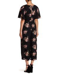 June & Hudson - Black Floral Faux Wrap Jumpsuit - Lyst