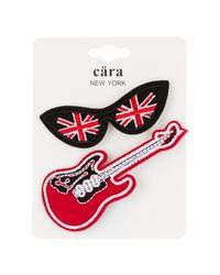 Cara | Red British Lenses & Guitar Pin - Set Of 2 | Lyst