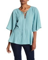 Cupcakes And Cashmere | Blue Josselyn Lace Up Blouse | Lyst