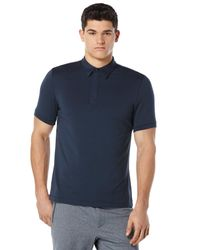Lyst - Perry Ellis Solid Zip Collar Active Polo in Blue for Men ef4079fe9