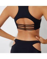River Island - Black Peekaboo Cut Out Bikini Top - Lyst