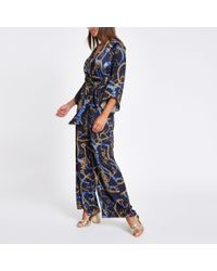 ad1ae196c75f River Island Navy Chain Print Wrap Tailored Leg Jumpsuit in Blue - Lyst