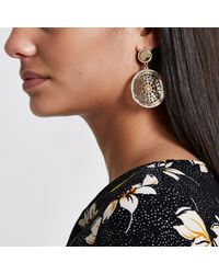 River Island - Metallic Gold Tone Filigree Disc Drop Earrings - Lyst
