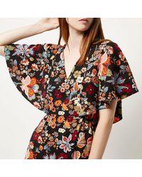 River Island - Black Floral Print Cape Dress - Lyst