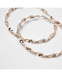 River Island - Metallic Rose Gold Tone Twist Hoop Earrings - Lyst