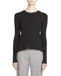 Nina Ricci | Black Stretch Knit Ruffle Top | Lyst