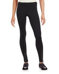 Romeo and Juliet Couture | Black Solid Zippered Leggings | Lyst