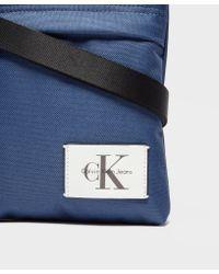 Calvin Klein - Blue Essential Small Grip Bag for Men - Lyst