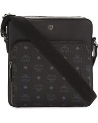 MCM | Black Ottomar Visetos Small Messenger Bag for Men | Lyst