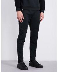 Versus | Black Embroidered-detail Stretch-jersey Jogging Bottoms for Men | Lyst