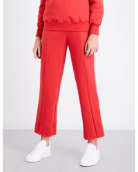 GOOD AMERICAN | Red Boyfriend-fit Cotton-jersey Jogging Bottoms | Lyst