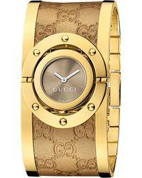 Gucci   Metallic Ya112434 Twirl Yellow Gold-plated Stainless Steel Cuff Watch   Lyst