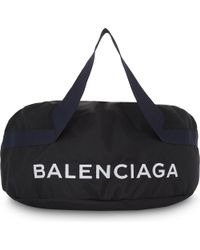 Balenciaga - Black Nylon Wheel Bag for Men - Lyst
