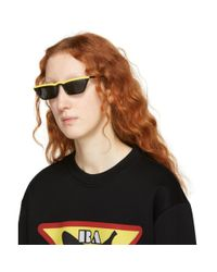 Prada - Black And Yellow Ultravox Sunglasses - Lyst