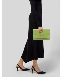 Cartier - Green Embossed Logo Clutch Lime - Lyst