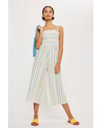 f9c4082b8b9 TOPSHOP Rainbow Striped Jumpsuit in Blue - Lyst