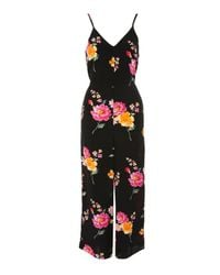79cd2a0ab6 Lyst - TOPSHOP Wide Leg Floral Jumpsuit in Black