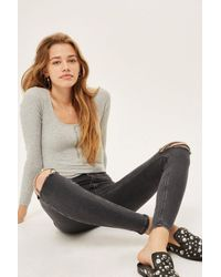 TOPSHOP - Washed Black Ripped Joni Jeans - Lyst