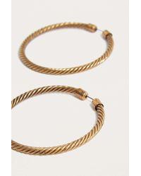 Urban Outfitters - Metallic Large Twisted Hoop Earrings - Lyst