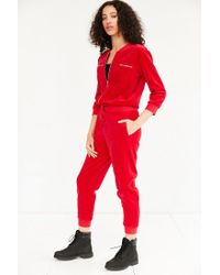 216bb5bddb1e Lyst - Juicy Couture For Uo Velour Coverall Jumpsuit in Red