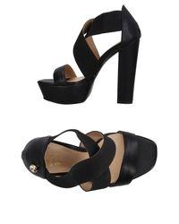Blu Byblos - Black Sandals - Lyst