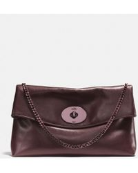 Coach Large Turnlock Clutch in Leather - Lyst