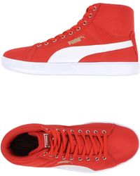 PUMA High-Tops & Trainers red - Lyst