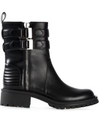Givenchy Buckled Calf-Leather Biker Boots black - Lyst