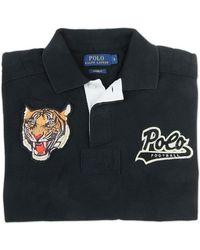 Ralph Lauren Blue Label Tiger Polo Shirt black - Lyst