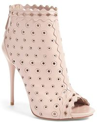 Alexander McQueen   Perforated Leather Ankle Boots   Lyst