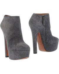 Alaïa Ankle Boots gray - Lyst