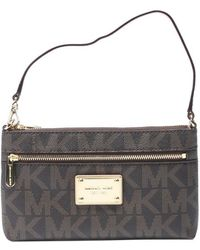 MICHAEL Michael Kors Brown Leather Logo Embossed Jet Set Large Wristlet - Lyst