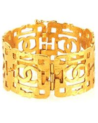 Chanel Pre-Owned Gold Cc Cutwork Wide Cuff gold - Lyst