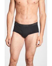 Calvin Klein Cotton Briefs, (4-Pack) black - Lyst