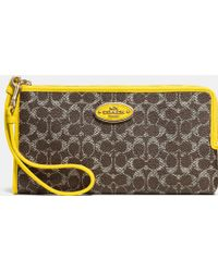 Coach L-Zip Wallet In Embossed Signature Canvas - Lyst