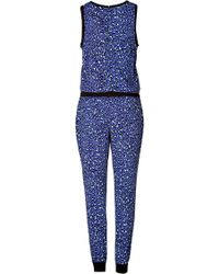 Juicy Couture Leopard Print Jumpsuit - Lyst