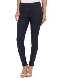 Nicole Miller Distressed Coated Denim Pant - Lyst