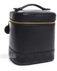 Chanel Pre-Owned Black Lambskin Vertical Cosmetic Case - Lyst