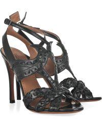 Alaïa Cutout Leather Sandals - Lyst