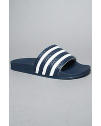Adidas The Adilette Sandals in Navy - Lyst