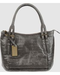 Coccinelle Medium Leather Bags - Lyst