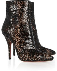 Alaïa Laser Cut Patent Leather Boots - Lyst