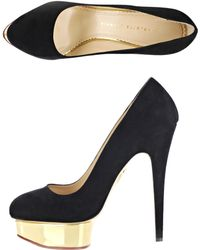 Charlotte Olympia Dolly Signature Shoes black - Lyst