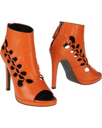 Giuseppe Zanotti x Christopher Kane Ankle Boots brown - Lyst