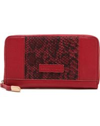 See By Chloé Ambre Zipped Wallet red - Lyst